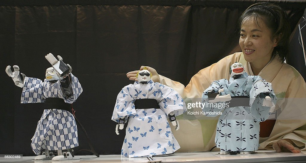 Dancing robot 'Eco-robots' of iXs Research Corp perform Japanese dance during 2005 International Robot Exhibition on November 30, 2005 in Tokyo, Japan The Exhibition is on until December 3.