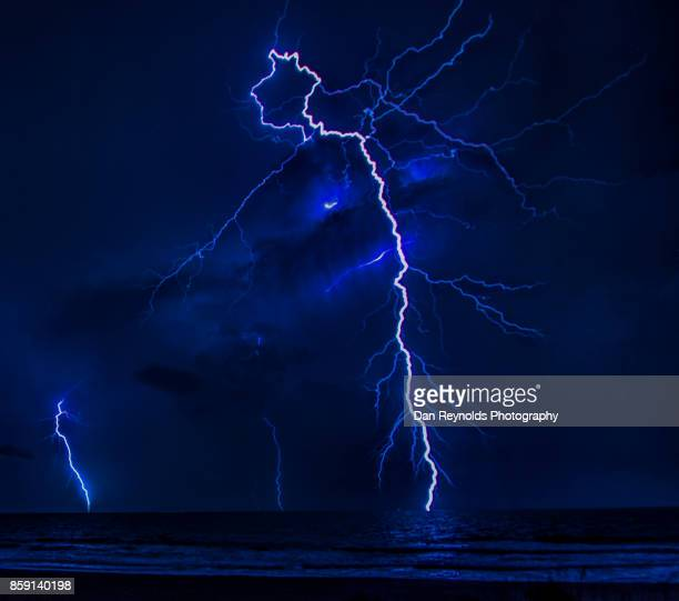 dancing sky as lighting bolt strikes during thunderstorm-close up - bolt stock photos and pictures