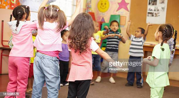 dancing to get rid of all the energy! - preschool student stock pictures, royalty-free photos & images