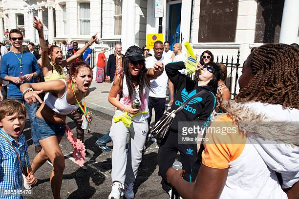 Dancing to live rappers at the Notting Hill Carnival in West London The Notting Hill Carnival is an annual event which since 1964 has taken place...