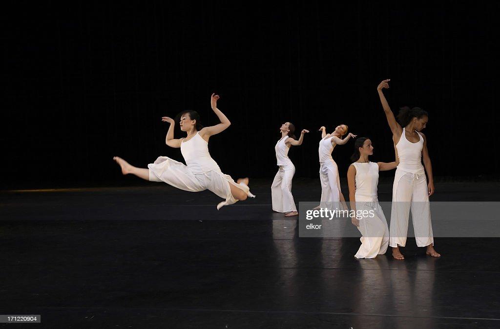 Dancing to music like wild swans : Stock Photo