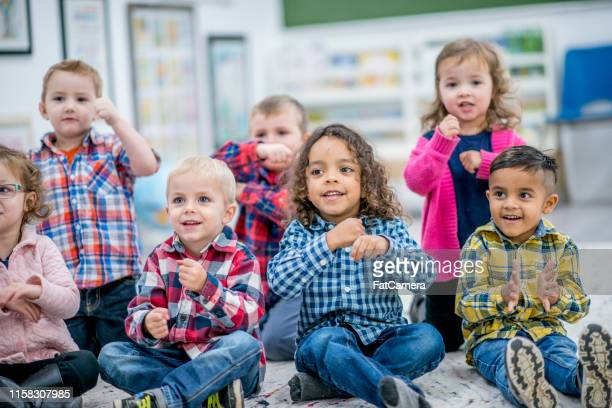 dancing to music - preschool child stock pictures, royalty-free photos & images