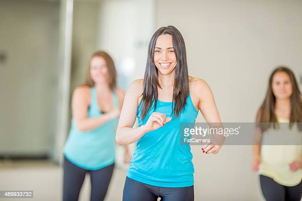 dancing to the music in fitness class - women wearing spandex stock photos and pictures