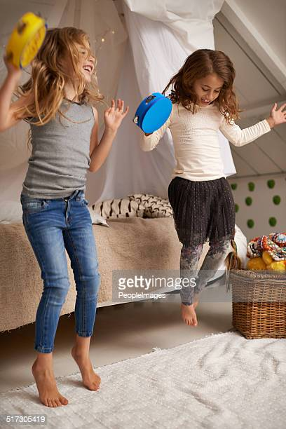 dancing to their own tune - tambourine stock photos and pictures
