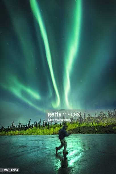 Dancing under the aurora borealis, Kluane National Park, Yukon Territory, Canada