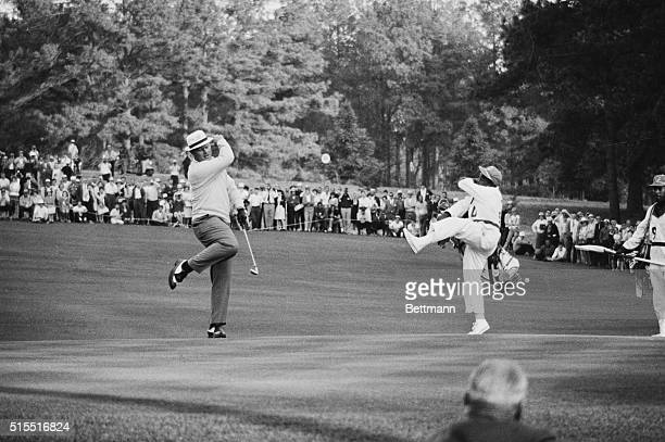 Dancing with delight, Jack Nicklaus and his caddie celebrate the birdie on the 15th hole, as Nicklaus staved off a last ditch charge by Tommy Jacobs...
