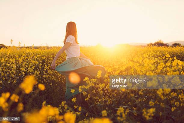 dancing with flowers - yellow stock pictures, royalty-free photos & images