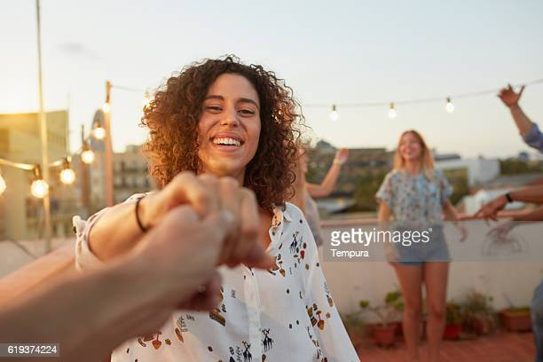 dancing with my girlfriend at a rooftop party from pov - cultura mediterrânica imagens e fotografias de stock
