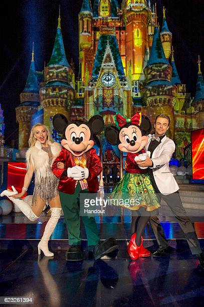 Dancing with the Stars judge Julianne Hough and prodancer Derek Hough pose with Mickey Mouse and Minnie Mouse in between takes during the taping of...