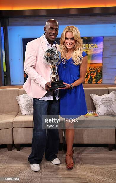 'Dancing With The Stars' winners Peta Murgatroyd and Donald Driver pose with the champions' mirrorball trophy on ABC's 'Good Morning America' in...