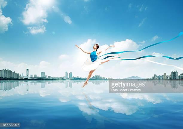 Dancing woman on the lake