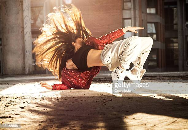 dancing woman - breakdancing stock photos and pictures
