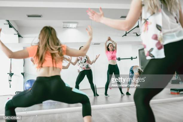 Dancing Zumba In Front Of Gym Mirror