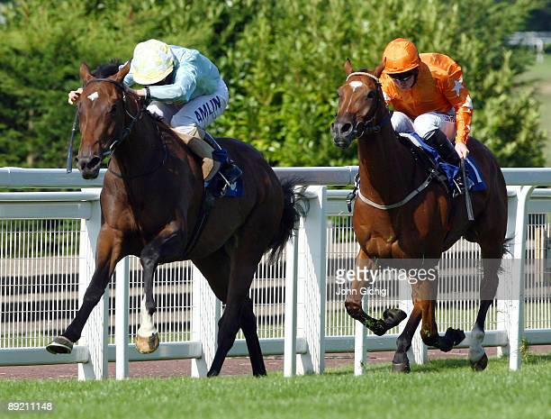 Dancourt ridden by Ryan Moore wins The Wisecall Claims Assistance Handicap Stakes on July 23 2009 at Sandown Park in Esher England