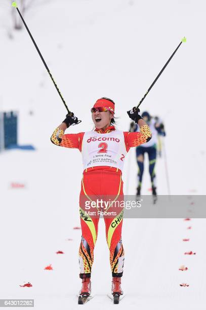 Dandan Man of China celebrates winning the Women's Cross Country 14 km Individual Sprint Classical on day three of the 2017 Sapporo Asian Winter...