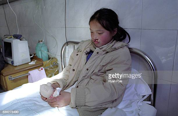 Dandan Meng 11 years old waits in the preoperation room In just a few minutes she will be moved to the surgery room at the Suqian People's Hospital...