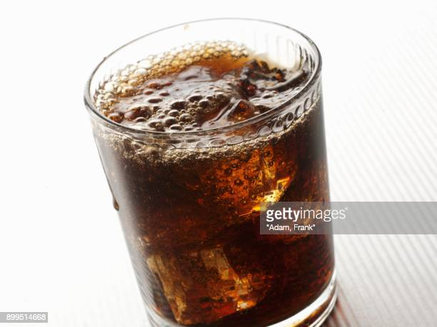 dandelion and burdock with ice cubes - carbon dioxide stock photos and pictures
