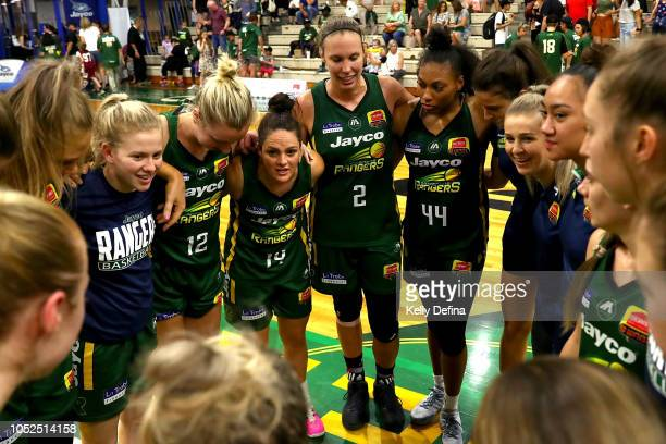 Dandenong Rangers players celebrate their win during the round two WNBL match between Dandenong and Sydney Uni on October 19 2018 in Dandenong...