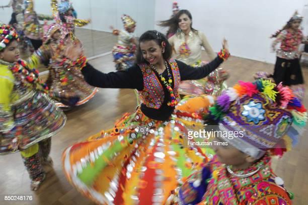 Dandiya dance practice for Navratri at workshop on September 20 2017 in Thane India