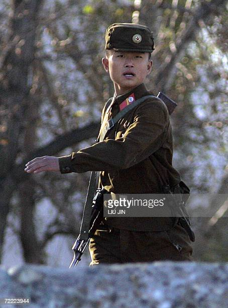 North Korean soldier patrols along the bank of the Yalu River in the North Korean town of Sinuiji, opposite Chinese border city of Dandong, 20...