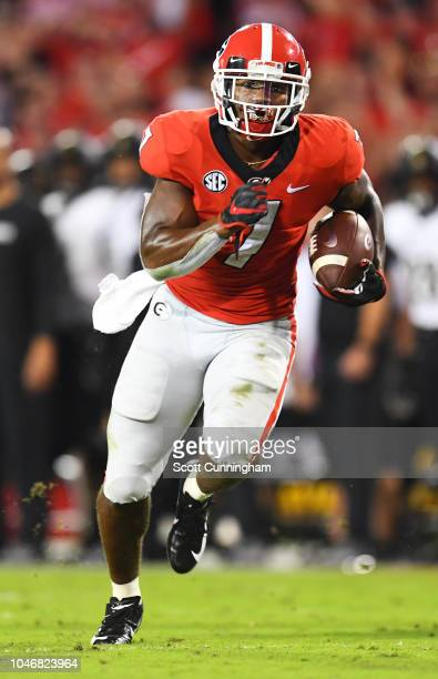 DAndre Swift of the Georgia Bulldogs carries the ball for a second half touchdown against the Vanderbilt Commodores on October 6 2018 at Sanford...