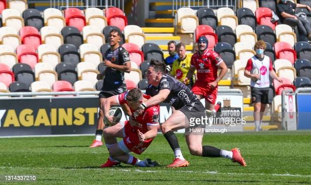 Dane Blacker of the Scarlets scores a try during the Guinness PRO14 Rainbow Cup match between Dragons and Scarlets at Rodney Parade on April 25, 2021...
