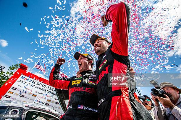 Dane Cameron L and Eric Curran celebrate after winning the IMSA WeatherTech Series race at Canadian Tire Motorsport Park on July 8 2016 in...