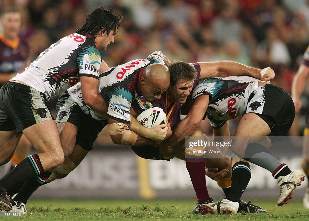 Dane Carlaw of the Broncos is tackled during the round three NRL match between the Brisbane Broncos and the Penrith Panthers at Suncorp Stadium March 30, 2007 in Brisbane, Australia.