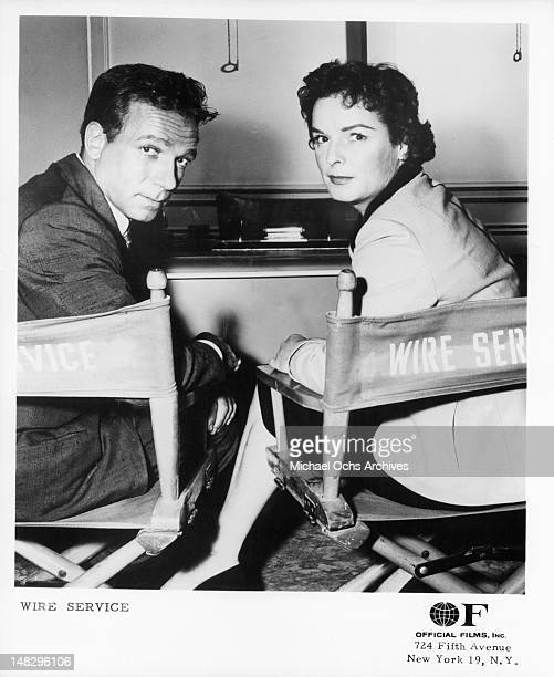 Dane Clark and Mercedes McCambridge sitting in director chairs from the television series 'Wire Service' 1956