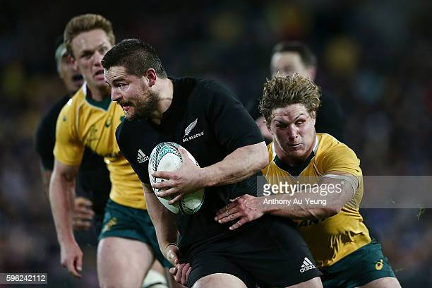 Dane Coles of New Zealand on the charge against Michael Hooper of Australia during the Bledisloe Cup Rugby Championship match between the New Zealand...
