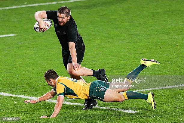 Dane Coles of the All Blacks beats the tackle of Nic White of the Wallabies to score a try during The Rugby Championship Bledisloe Cup match between...