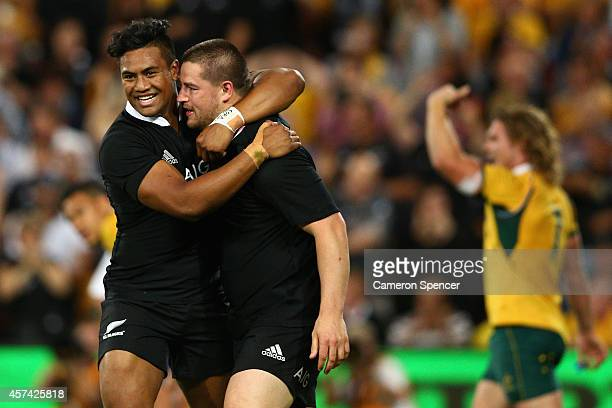 Dane Coles of the All Blacks is congratulated by team mate Julian Savea after scoring a try during The Bledisloe Cup match between the Australian...