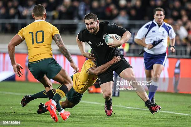 Dane Coles of the All Blacks is tackled during the Bledisloe Cup Rugby Championship match between the New Zealand All Blacks and the Australia...