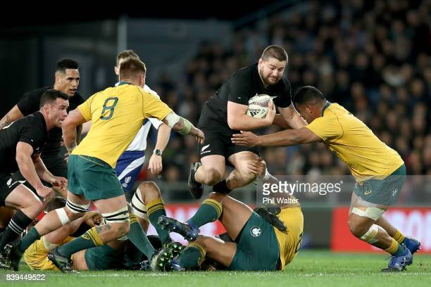 Dane Coles of the All Blacks is tackled during The Rugby Championship Bledisloe Cup match between the New Zealand All Blacks and the Australia...