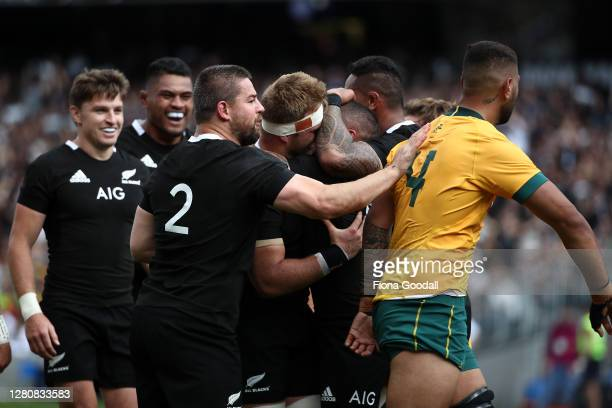 Dane Coles of the All Blacks pats Lukhan Salakaia-Loto of the Wallabies on the back during the Bledisloe Cup match between the New Zealand All Blacks...