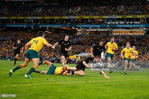 Dane Coles of the All Blacks scores a try during the Bledisloe Cup Rugby Championship match between the Australian Wallabies and the New Zealand All...