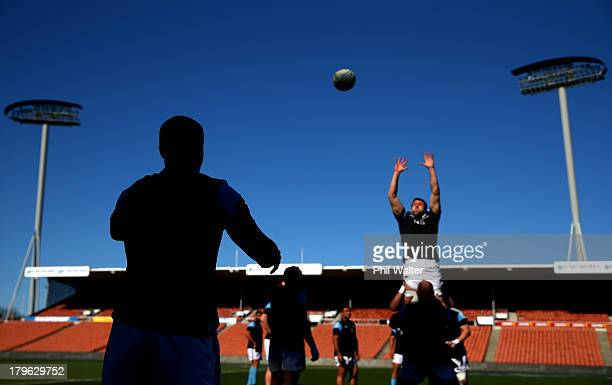 Dane Coles of the All Blacks throws the ball into the lineout during a New Zealand All Blacks Captain's Run at Waikato Stadium on September 6 2013 in...