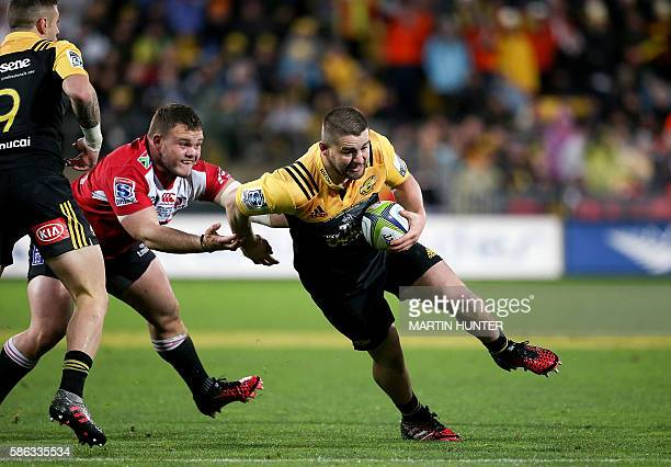 Dane Coles of the Hurricanes breaks through a tackle during the Super Rugby final match between the Wellington Hurricanes and Lions of South Africa...