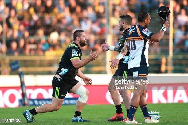 Dane Coles of the Hurricanes celebrates with TJ Perenara after scoring a try during the round three Super Rugby match between the Hurricanes and the...