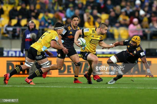 Dane Coles of the Hurricanes charges forward during the round 9 Super Rugby Aotearoa match between the Hurricanes and the Chiefs at Sky Stadium on...