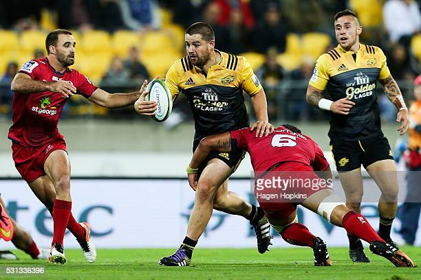 Dane Coles of the Hurricanes is tackled by Hendrik Tui of the Reds during the round 12 Super Rugby match between the Hurricanes and the Reds at...