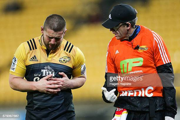 Dane Coles of the Hurricanes receives medical attention after sustaining an injury to his ribs during the Super Rugby Quarterfinal match between the...