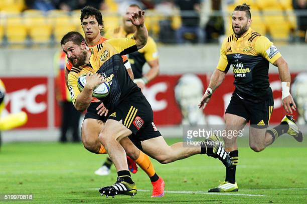 Dane Coles of the Hurricanes runs in for a try during the round seven Super Rugby match between the Hurricanes and the Jaguares at Westpac Stadium on...