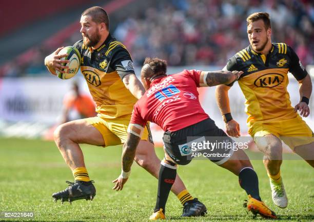 Dane Coles of the Hurricanes runs past Elton Jantjies of the Lions during the Super Rugby semifinal match between Lions and Hurricanes at Ellis Park...