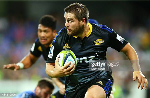 Dane Coles of the Hurricanes runs the ball during the round three Super Rugby match between the Western Force and the Hurricanes at nib Stadium on...