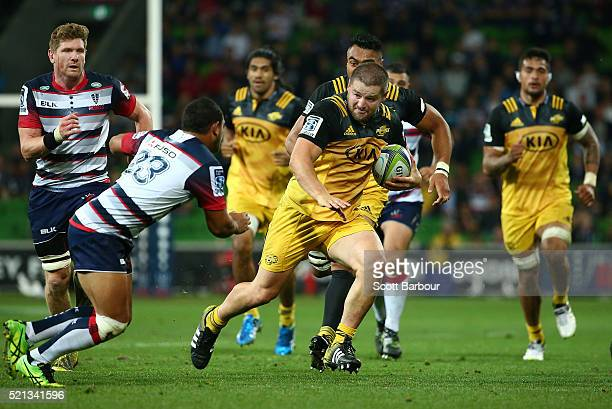 Dane Coles of the Hurricanes runs with the ball during the round eight Super Rugby match between the Rebels and the Hurricanes at AAMI Park on April...