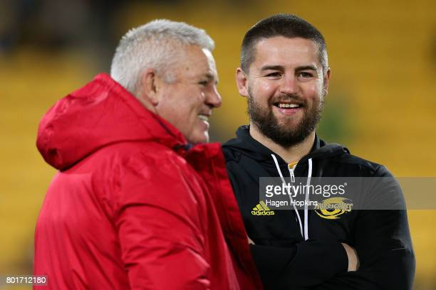 Dane Coles of the Hurricanes speaks to Head Coach Warren Gatland of the Lions looks on during the match between the Hurricanes and the British Irish...