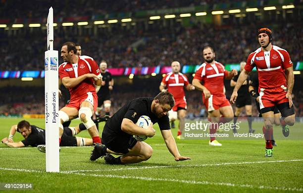 Dane Coles of the New Zealand All Blacks scores their fourth try during the 2015 Rugby World Cup Pool C match between New Zealand and Georgia at the...