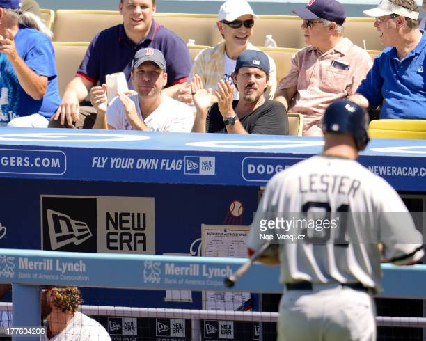 Dane Cook attends a baseball game between the Boston Red Sox and Los Angeles Dodgers at Dodger Stadium on August 24 2013 in Los Angeles California