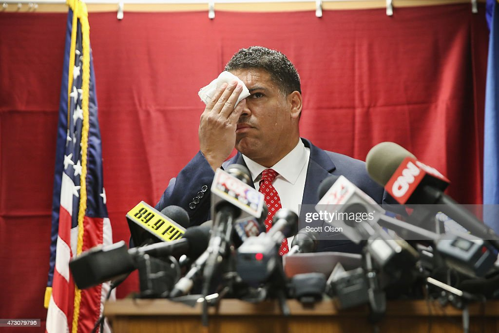 Dane County District Attorney Ismael Ozanne speaks wipes his brow during a press conference on May 12, 2015 in Madison, Wisconsin. Ismael Ozanne announced no charges will be filed for Officer Matt Kenny in the death of unarmed teen Tony Robinson.